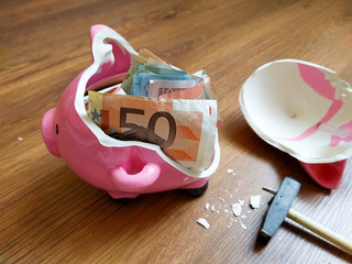 A broken pig piggy bank Euros inside