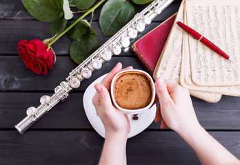 Musical background, poster - flute, rose, coffee, notes, symphony orchestra. Musical still life.