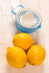 Fresh yellow lemons with plastic strainer