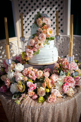 a large wedding cake with fresh flowers