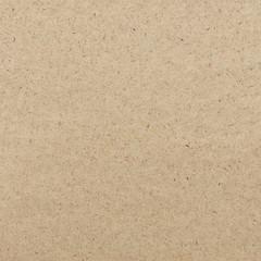 Close-up view of dark brown craft paper texture background.
