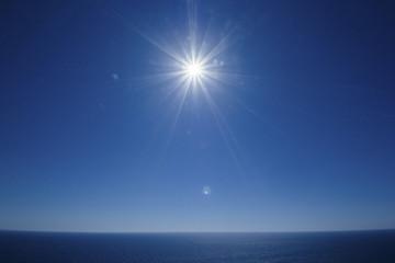 The sun shines over the Mediterranean  sea at Zakynthos cliffs, Greece