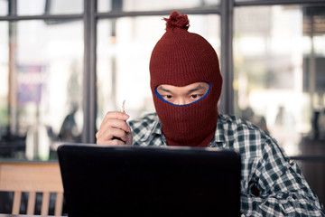 electronic crime concept. hacker is using computer.