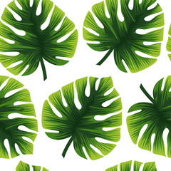 Seamless tropical ornament. Beautiful flowers and green leaves.
