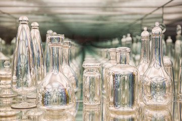 Glass bottles reflected in the mirror. recursive view