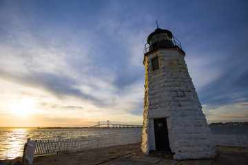 Sunset over the Goat Island Lighthouse, Newport, RI with Pell Bridge and Rose Island Light House as a backdrop.