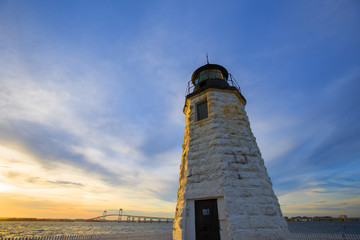 Sunset over the Goat Island Lighthouse, Newport, RI with Rose Island Light House as a backdrop.
