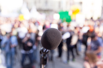 Protest. Public demonstration. Microphone.