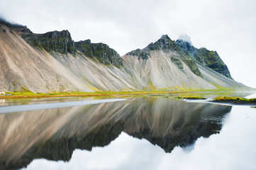 Mountains on the coast of Atlantic ocean. Iceland