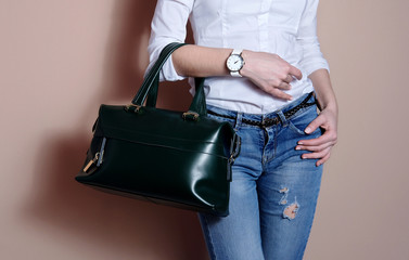 Wall Mural - Woman in hand big green trendy leather bag. accessory