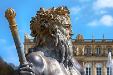 Neptun statue on Baroque fountain.Detail of sculpture of Poseidon from the fountain of the Castle of Ludwig The Bavarian on Island Herreninsel,Chiemsee,Bavaria,German.