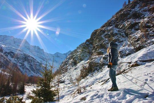 Girl trekking in Valnontey, Aosta Valley, Great Paradise National Park, Italy