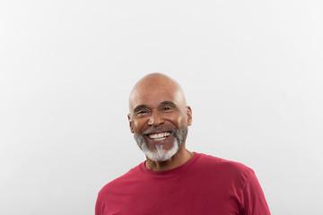 Studio portrait of a man grinning