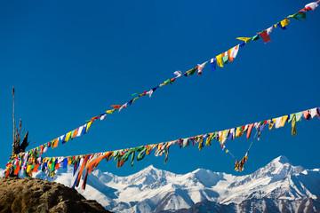 Fototapeta Buddhist prayer flags above the Indian Himalayas in Leh, Ladakh, India obraz