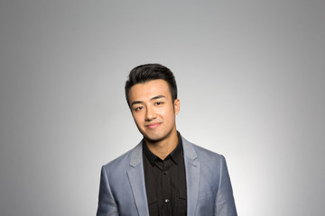 Studio portrait of a thoughtful businessman