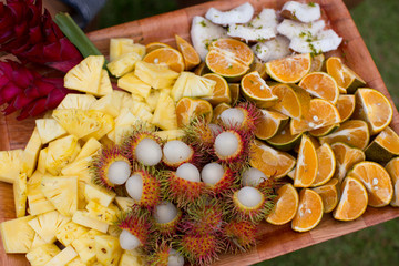 Assorted tray of tropical fruit, close up