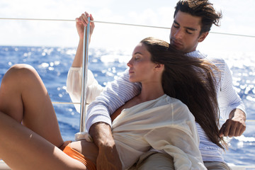 Couple relaxing on boat, Tahiti, South Pacific