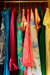 Women's Summer clothing hanging in a wardrobe
