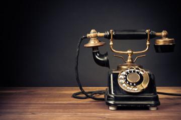 Vintage old telephone on wood table