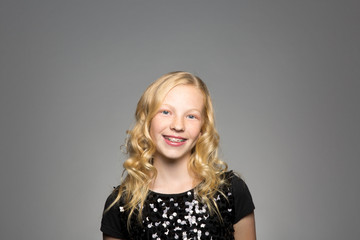 Studio portrait of an excited girl