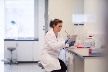 Female scientist using digital tablet