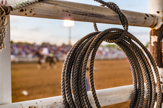 Rope tied to a fence at a rodeo