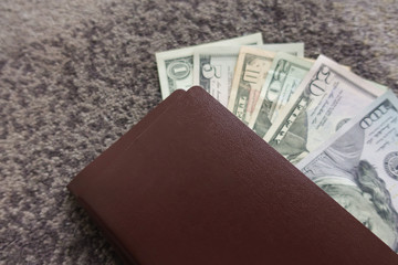A lot of one hundred dollar bills in a bag plan for travel