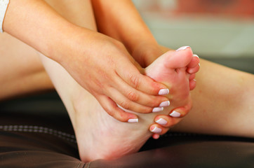 Pain in the foot, auto massage of female feet.