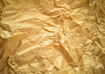 Crumpled paper texture background. Craft paper sheet, brown colo
