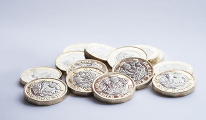 British money, new pound coins in small pile