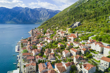 Beautiful city with red roofs in the mountains near the sea