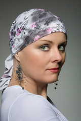 beautiful middle age woman cancer patient wearing headscarf