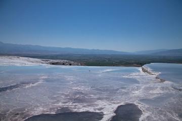 travel to turkish beautiful limestone hot natural turquoise springs cotton castle background, pamukkale, turkey