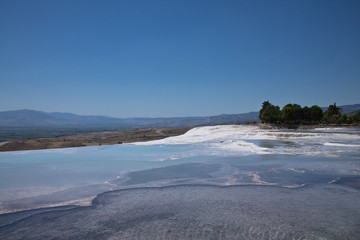 amazing landscape with beautiful turquoise hot springs in pammukale, turkey