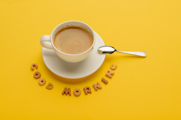 Close-up view of cup of fresh hot coffee and good morning inscription