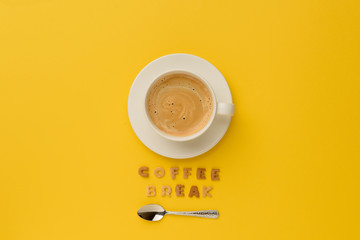 top view of cup of espresso coffee, spoon and coffee break lettering