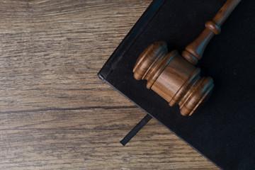 Judge's hammer on black notebook