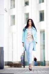 Beautiful girl walking on street
