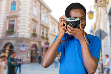 Young African man with camera