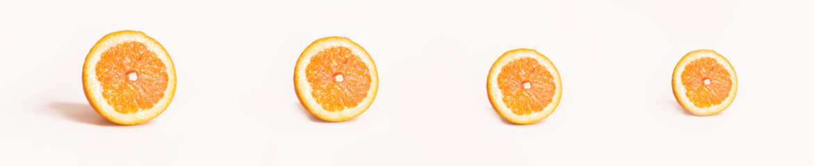 Bright and Fresh Orange slices in a Panoramic Image For Skinali.