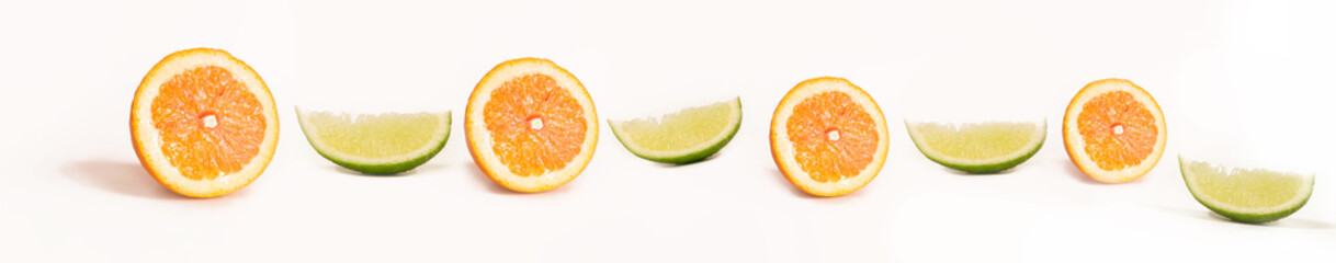 Panoramic Bright and Fresh Orange, Lime for Skinali. Colorful Citrus Fruit Slices Background. White Backside.
