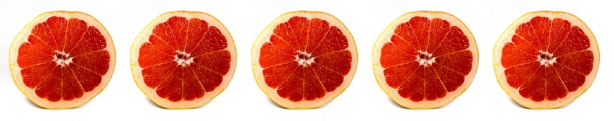 Bright and Fresh Grapefruit Slices in a Panoramic Image