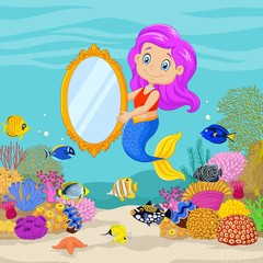 Cute mermaid holding a classic mirror in underwater background