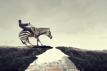 Wall Mural - Businesswoman ride zebra