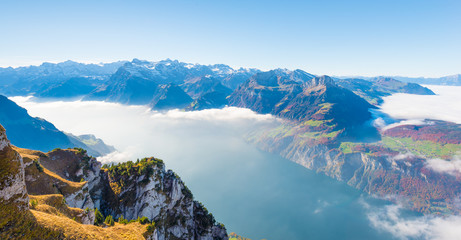 Recreation idyll in the heart of Central Switzerland, high above Lake Lucerne. Aerial photography. A view of the clouds from above, above the clouds. A sunny autumn day with fog and bright foliage.