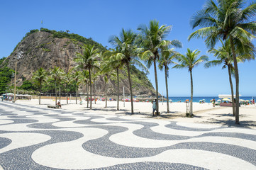 Scenic landscape view of Copacabana Beach from the palm tree-lined boardwalk