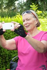 senior woman taking photo phone