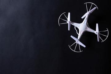 Photo of white quadrocopter on black background