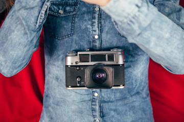 Young beautiful Girl with retro camera