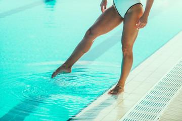 Female swimmer on poolside